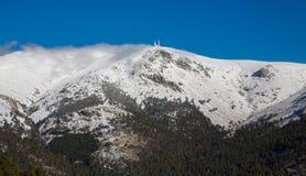 Snowy mountains and world ball Stock Photos
