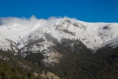 Snowy mountains and world ball Royalty Free Stock Image