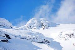 Snowy mountainside. Deep, heavy snow on a high mountain side.  Balea Lac, Romania Stock Photo