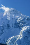Snowy Mt. Nilgiri north face and summit against blue sky Royalty Free Stock Images