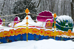 Snowy multicolored attraction in winter park during snowfall Royalty Free Stock Images