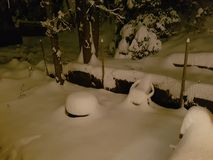 Snowy night. Backyard after a huge dump of snow Royalty Free Stock Image