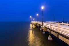 Snowy pier at Baltic Sea in Gdansk. Snowy night at the Baltic Sea pier in Gdansk, Poland Stock Photo