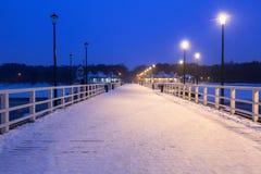 Snowy pier at Baltic Sea in Gdansk. Snowy night at the Baltic Sea pier in Gdansk, Poland Royalty Free Stock Photos