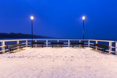 Snowy pier at Baltic Sea in Gdansk. Snowy night at the Baltic Sea pier in Gdansk, Poland Royalty Free Stock Image