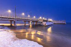 Snowy night at the Baltic Sea pier in Gdansk. Poland Stock Photo