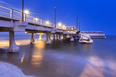 Snowy night at the Baltic Sea pier in Gdansk. Poland Royalty Free Stock Photo
