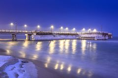 Snowy night at the Baltic Sea pier in Gdansk. Poland Stock Images