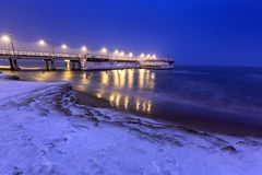 Snowy night at the Baltic Sea pier in Gdansk. Poland Royalty Free Stock Image