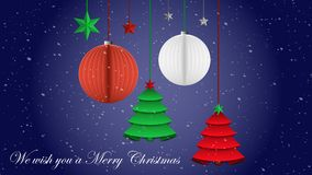 Snowy night sky with green, white and red oirigami Christmas ornaments. On the snowy night of Christmas day, origami Christmas ornaments hang in the form of Stock Image