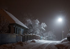 Snowy night in the village Stock Photography