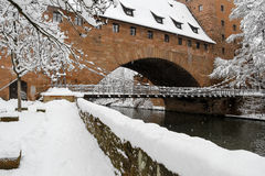 Snowy Nuremberg, Germany- iron bridge ( Kettensteg), old town city walls Stock Images