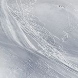 Snowy off-piste slope with traces of skis and snowboards Stock Image