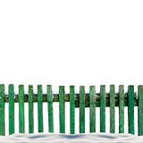 Snowy old green wooden fence isolaten on white background Royalty Free Stock Images