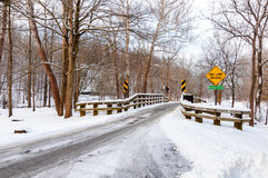 Snowy one-lane bridge Royalty Free Stock Photo