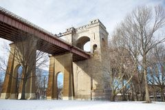 Snowy Park Bridge. A bridge stands in a snowy park stock image