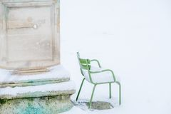 Snowy Park Chair in Paris. At the Tuileries Gardens after a snowstorm Stock Image