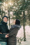In a snowy park husband and wife Stock Photography