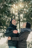 In a snowy park husband and wife Stock Image
