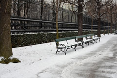 Snowy park seats Stock Photos