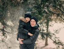 In a snowy park son with his father Royalty Free Stock Image