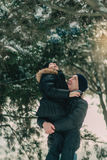 In a snowy park son with his father Royalty Free Stock Images