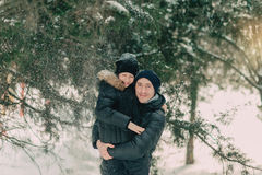 In a snowy park son with his father Stock Photography
