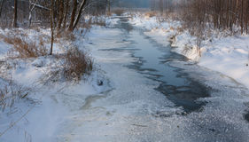 Partly frozen river in morning Stock Image