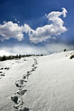 Snowy path on the hill Stock Photography