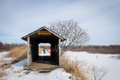 Snowy path to the bridge Stock Photo
