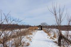 Snowy path to the bridge Royalty Free Stock Photo