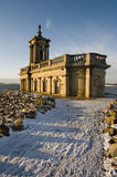 Snowy path to church. Normanton church is struck by a warm winter light royalty free stock photography