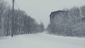 Snowy path with trails. Winter landscape, falling snow, covered with fresh powder. Snowy path with trails. Winter landscape with falling snow. Everything is stock footage