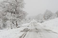 Snowy path trough the wood. Between villages Royalty Free Stock Image