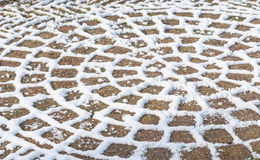 Snowy pattern on the terrace tiles Stock Photography