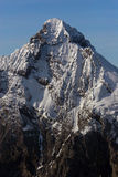Snowy Peak. In the swiss Alps Stock Image