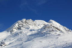 Snowy peak. A mountain peak in Iscghl area in austrian Alps royalty free stock image