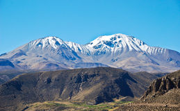 Snowy peak in the Atacama desert. In Chile Royalty Free Stock Photos