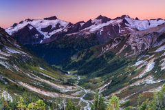Snowy peak and green vally Royalty Free Stock Images