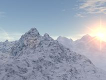 Snowy Peaks. The sun glows pink as it sinks behind a series of snowy mountain tops Stock Photos