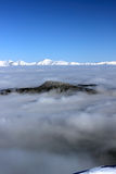 Snowy peaks. Above the clouds Tatras Slovakia Royalty Free Stock Photography