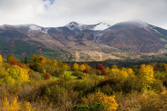 Snowy peaks and autumnal colurs in the Daisetsuzan Royalty Free Stock Photography