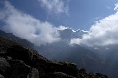Snowy peaks in the clouds. Trekking to Annapurna Base Camp. Nepal royalty free stock photos