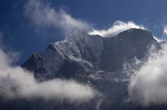 Snowy peaks in the clouds. Trekking to Annapurna Base Camp. Nepal royalty free stock image