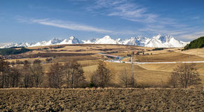 Snowy peaks of High Tatras mountains and landsccape. Royalty Free Stock Image