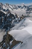 Snowy peaks and mountains in a sunny day royalty free stock image