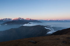 Snowy peaks panorama with amazing clouds floating. Stock Photo