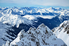 Snowy peaks panorama. Winter panorama from the top of mount valluga  in the snowy mountains of the arlberg ski area in the tyrolean alps Stock Image