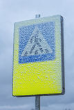Snowy pedestrian crossing sign Stock Photo