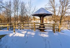 Snowy Photo of the Park on a Sunny Winter day - Wooden Footpath in the Middle of it, Concept of the Harmony and Travel. In the Countryside stock images